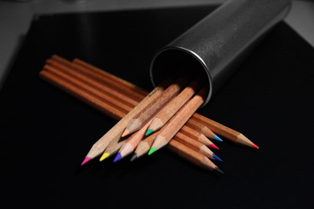 Colour pencils sitting in their tin